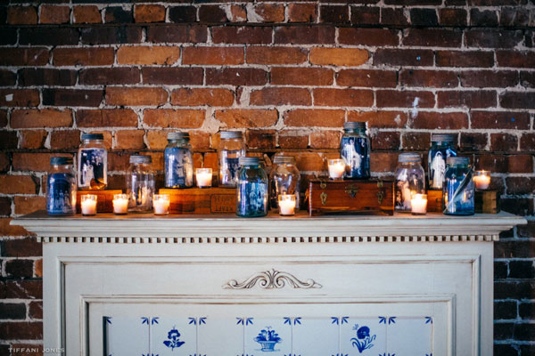 Mason Jar display of family wedding portraits on a mantle | photo by Tiffani Jones